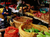 Trader at Market Stall in Old Town, Lijiang, Yunnan, China Photographic Print by Richard I'Anson