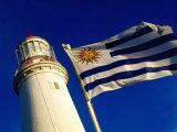 Faro del Cabo de Santa Maria Lighthouse and Uruguayan Flag, La Paloma, Rocha, Uruguay Photographic Print by Krzysztof Dydynski
