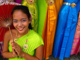 Girl Selling Dresses and Costume Materials Outside Temple of Dawn, Bangkok, Bangkok, Thailand Photographic Print by Dominic Bonuccelli