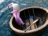 Woman Rows Basket Boat on Vietnam's South Central Coast, Nha Trang, Khanh Hoa, Vietnam Photographic Print by Stu Smucker