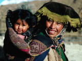 Mother Carrying Daughter Swathed in Hand Woven Fabrics, Peru Photographic Print by Richard I'Anson