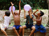 Local Boys Toss Balloons Outside Preah Kahn Temple, Siem Reap, Cambodia Photographic Print by Daniel Boag