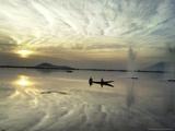 Kashmiri Women Row their Shikara in Dal lake in Srinagar, India Photographic Print by Mukhtar Khan