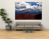 The Sun Breaks Through the Clouds to Highlight the Summit of Pikes Peak Wall Mural