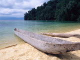 Beached Canoe on Lake Poso, Sulawesi, Indonesia Photographic Print by Jay Sturdevant