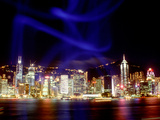 Skyline at Night Reflected in Victoria Harbour, Kowloon, Hong Kong Photographic Print by Russell Gordon