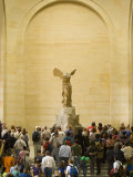 Interior of The Louvre Museum Showing Winged Victory Statue and Tourists, Paris, France Photographic Print by Jim Zuckerman