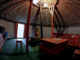 Yurt and Traditional Furniture, Golden Eagle Festival, Mongolia Photographic Print by Amos Nachoum