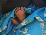 Child's Feet Wrapped with Sari at Kunbuli Friday Market, Orissa, India Photographic Print by Keren Su