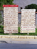 Road Signs to Wine Producers in Chateauneuf-Du-Pape, France Photographic Print by Per Karlsson