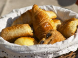 Wicker Basket with Croissants and Breads, Clos Des Iles, Le Brusc, Var, Cote d'Azur, France Photographic Print by Per Karlsson