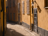 Cobblestone Street in Gamla Stan, Iron Cellar Door and Old Lamp, Stockholm, Sweden Photographic Print by Per Karlsson