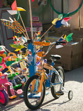 Bicycle Outside Toy Shop, Lesvos, Mytilini, Aegean Islands, Greece Photographic Print by Walter Bibikow