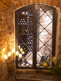 Wine Cellar with Bottles Behind Iron Bars, Stockholm, Sweden Photographic Print by Per Karlsson