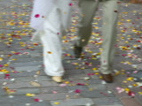 Newly Wed Couple Walk on Street with Flower Petals, Vilnius, Lithuania Photographie par Keren Su