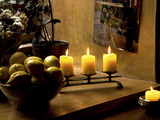Still Life with Lighted Candles and Bowl of Lemons in Coffee Shop, Tallinn, Estonia Photographic Print by Nancy & Steve Ross