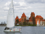 Sailboat with Island Castle by Lake Galve, Trakai, Lithuania Photographic Print by Keren Su