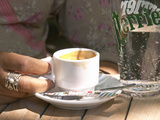 Espresso Coffee Cup and Glass of Perrier Water on Cafe Table, Toulon, Var, Cote d'Azur, France Photographic Print by Per Karlsson