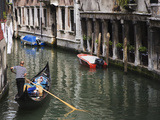 Gondola with Passengers on a Canal, Venice, Italy Photographic Print by Dennis Flaherty