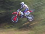 Motocross Racer Airborne Photographie par Steve Satushek