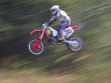 Motocross Racer Airborne Photographic Print by Steve Satushek