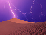 Lightning Bolts Striking Sand Dunes, Death Valley National Park, California, USA Photographic Print by Steve Satushek