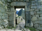 View Through Stone Doorway of the Inca Ruins of Machu Picchu in the Andes Mountains, Peru Photographie par Jim Zuckerman