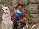 Woman with Llama, Boy, and Parrot, Sacsayhuaman Inca Ruins, Cusco, Peru Photographic Print by Dennis Kirkland