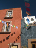 Banners in Street, San Miguel De Allende, Mexico Photographic Print by Nancy Rotenberg