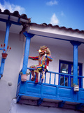 Man on Balcony Rail During Village Festival, Chinceros, Peru Photographic Print by Jim Zuckerman