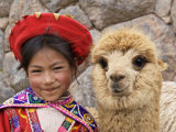 Girl in Native Dress with Baby Alpaca, Sacsayhuaman Inca Ruins, Cusco, Peru Fotografie-Druck von Dennis Kirkland