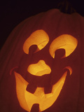 Jack-O-Lantern Lit at Halloween, Washington, USA Photographic Print by John & Lisa Merrill