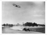The Airplane Races the Automobile Foto