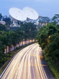 Traffic Rushes Past the Bukit Timah Satellite Earth Station at Night Photographic Print by  xPacifica
