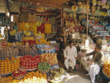 Fruit and Basketware Stalls in the Market, Karachi, Pakistan Photographic Print by Robert Harding