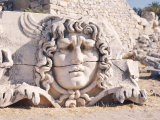 Carved Head of Medusa at the Archaeological Site of Didyma, Turkey Photographic Print by Richard Ashworth