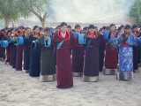 Tibetan Women Pray at Harvest Festival, Tongren Area, Qinghai Province, China Photographic Print by Gina Corrigan