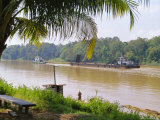 Logging Barge on the Kinabatangan River, Eastern Sabah, Island of Borneo, Malaysia Photographic Print by Richard Ashworth