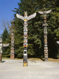 Totems in Stanley Park, Vancouver, British Columbia, Canada Photographic Print by Robert Harding