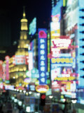 Blurred Neon Lights at Night, Nanjing Dong Lu New Pedestrian Street, Nanjing Road, Shanghai, China Photographic Print by Gavin Hellier