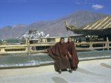 Two Tibetan Buddhist Monks at Jokhang Temple, with the Potala Palace Behind, Lhasa, Tibet, China Photographic Print by Sybil Sassoon