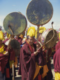 Yellow Hat Tibetan Buddhist Monks Playing Drums at Festival, Naqu (Nagchu) (Nakchu), Tibet, China Photographic Print by Maurice Joseph