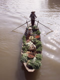 Floating Market Trader and Boat Laden with Vegetables, Phung Hiep, Mekong River Delta, Vietnam Photographic Print by Gavin Hellier