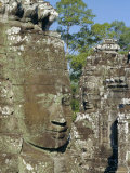 Myriad Stone Heads Typifying Cambodia in the Bayon Temple, Angkor, Siem Reap, Cambodia Photographic Print by Gavin Hellier