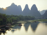 In Guilin Limestone Tower Hills Rise Steeply Above the Li River, Yangshuo, Guangxi Province, China Photographic Print by Anthony Waltham