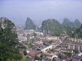 Limestone Towers in the City of Guilin, Guangxi Province, China Photographic Print by Anthony Waltham