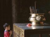 Boy Praying at Kek Lok Si Temple, Penang, Kuala Lumpur, Malaysia, Asia Photographic Print by Charcrit Boonsom