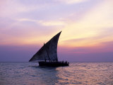 Dhow in Silhouette on the Indian Ocean at Sunset, off Stone Town, Zanzibar, Tanzania, East Africa Photographic Print by Lee Frost