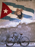 Mural of Camilo Cienfuergos on Wall Above a Bicycle, Havana, Cuba, West Indies, Central America Photographic Print by Lee Frost