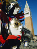 Carnival Masks on Souvenir Stand and Campanile, St. Marks Square, Venice, Veneto, Italy Photographic Print by Lee Frost